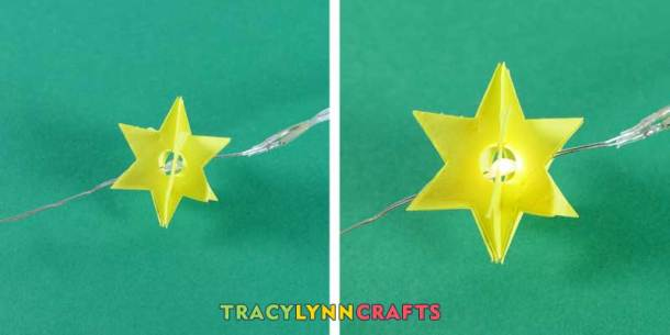 String the stars onto the LED strand and glue into place