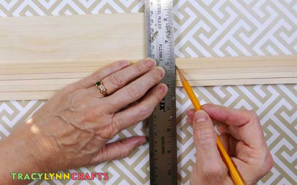 Mark the basswood sticks with a pencil to the width of the base board and cut