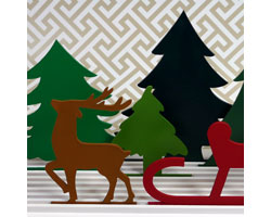 These chipboard cutouts of a wintry scene can be rearranged on the slotted base - another cute addition to your holiday decorating