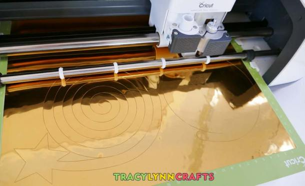 The Cricut cutting the party foil spiral streamers
