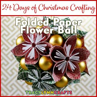 These origami paper flowers can be made into a holiday decoration using red and green papers