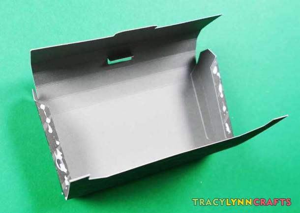 Glue the tabs to the back and front of the toolbox