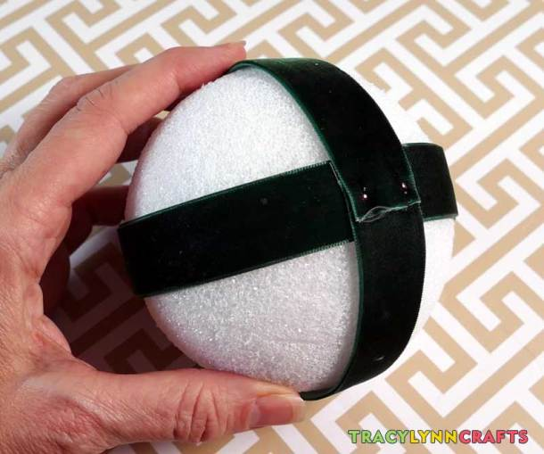 Wrap ribbon around the ball and secure with flat headed pins