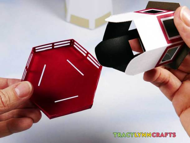 3D Paper Lighthouse - Align the tabs to the slots on the railing piece and insert