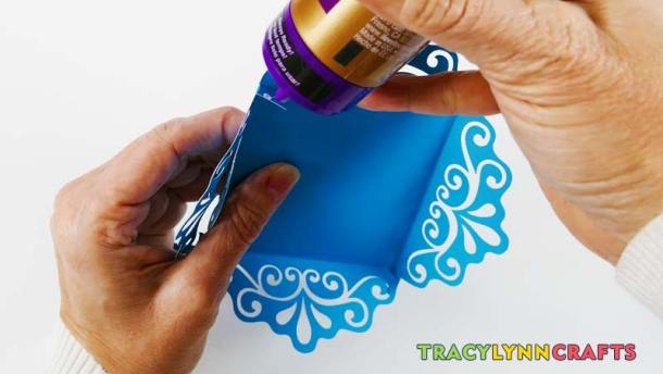 Add a little glue to the tabs for the top piece of the decorative cupcake box to help it hold its shape