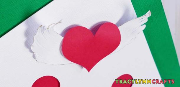 "By ""scratching"" at the card stock, you can encourage a little curve and dimension to the heart before attaching it to the shadow box heart art."