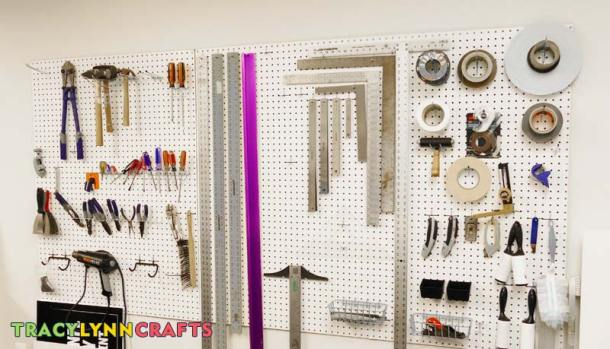 Sign shop wall of tools. Use this as inspiration for your craft room organization.