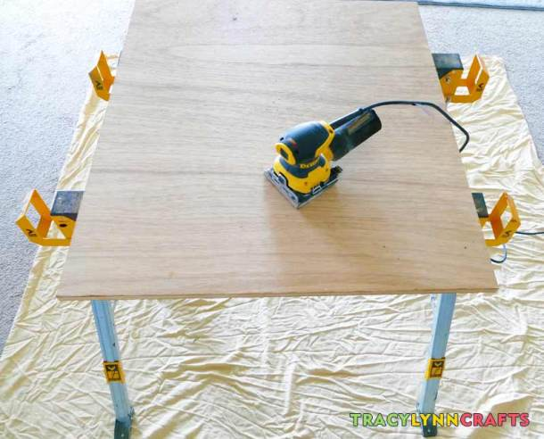 Give your drop leaf craft table wood components a good sanding to remove any splinters or rough spots