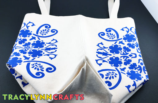 Completed stenciling showing both sides of the bag
