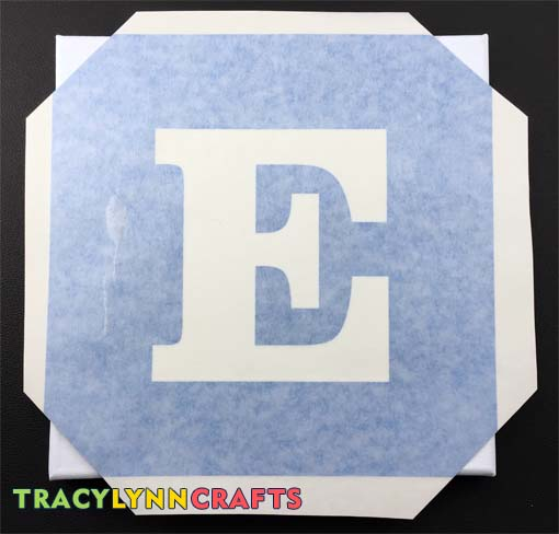 Cut off the corners of the vinyl stencil and align to the four corners of the panels