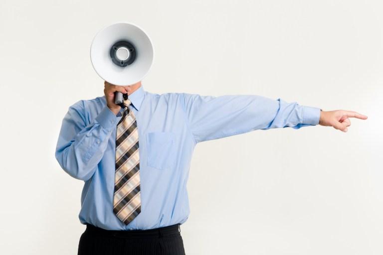 Canva-Man-With-Megaphone-Pointing-1024x683 Perché a tutti piacciono i servizi di Tips?