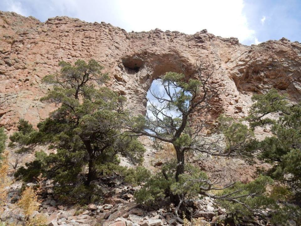 """At this point, the """"trail"""" is about done and its clamoring over loose rocks amid the junipers."""