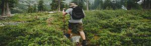 Man hiking on a wilderness survival school adventure