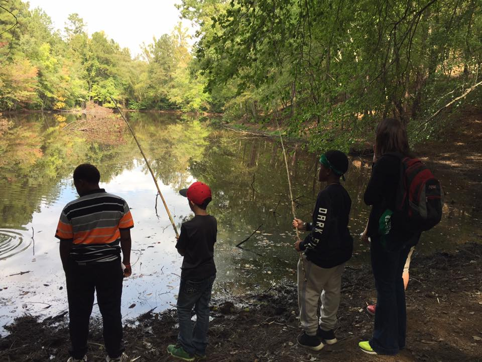 photo of youth fishing at survival camp