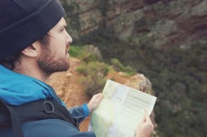 a hiker pondering a map