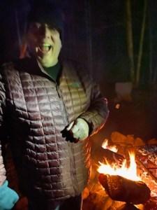 a happy man at a campsite