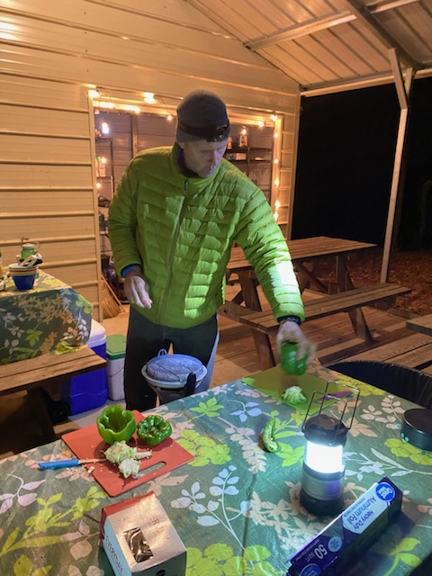 a man cooking at a campsite