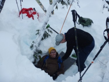 Once the searchers had uncovered the 2nd buried beacon, Ian jumped in as a subject with a broken leg.