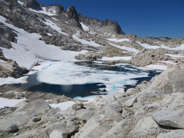 A blue slushy lake below Little Annapurna