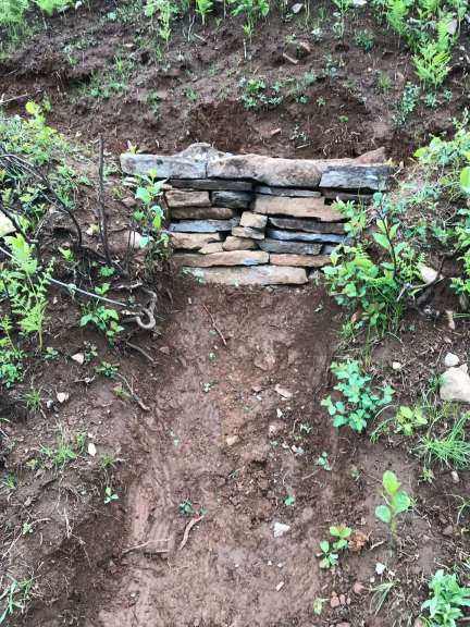 A dry-rock wall fills a gap where trail had washed out.