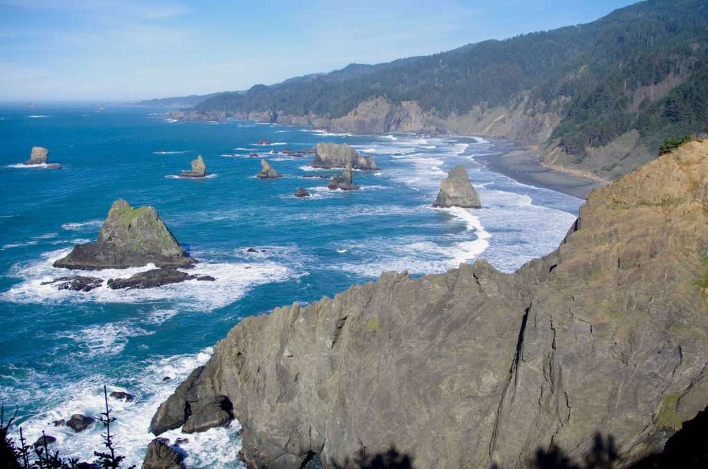 A secluded coastal beach and rugged rocky headlands.