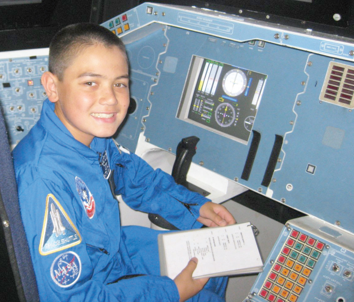 child in simulated space shuttle