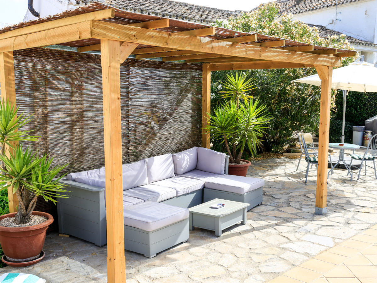 Lounge around on the sofa under our Pergola