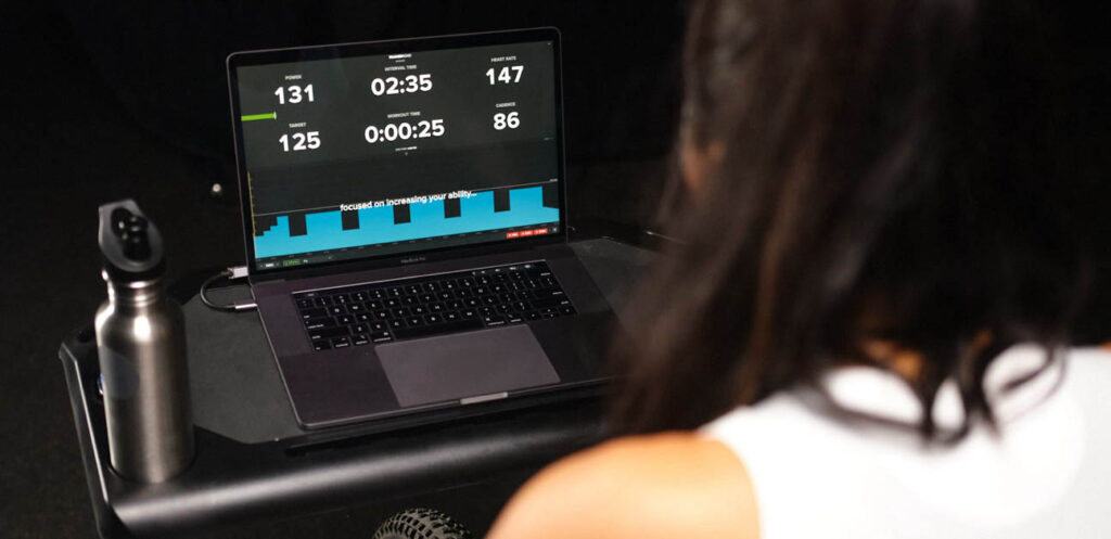 A cyclist riding an structured TrainerRoad indoor workout.