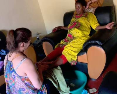 Tina Lytch, Birth Doula, Giving a Foot Massage in Africa