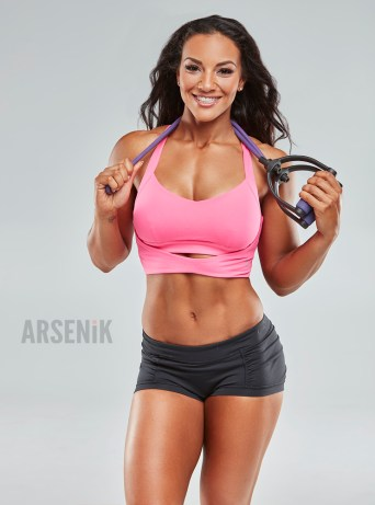 Alicia Bell - Fitness Trainer with exercise band.