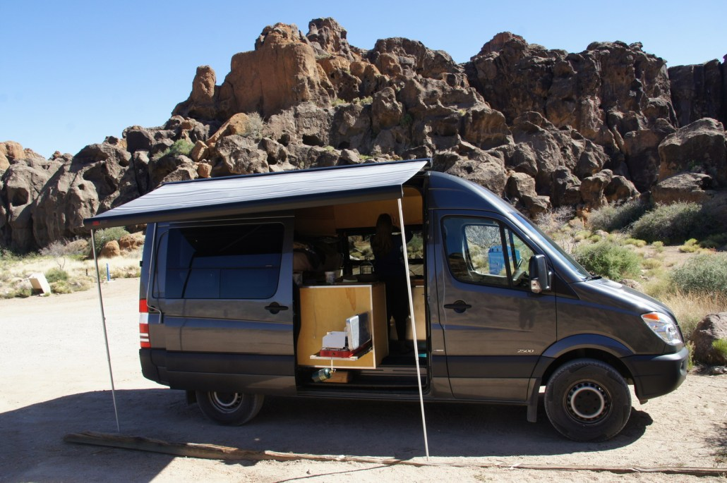 The Sprinter in action in the Mojave National Preserve. Awning and stove out while cooking a meal and enjoying the view.