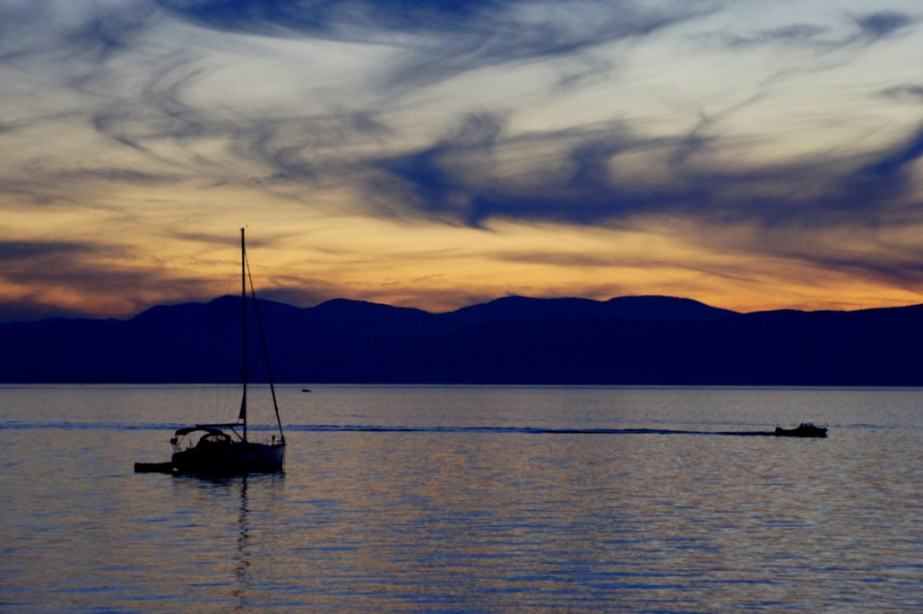 """Sunset looking across Lake Champlain after our ferry ride from New York to Vermont. As a new friend in NY joked, """"what's the best thing about Vermont? The view of New York!"""""""