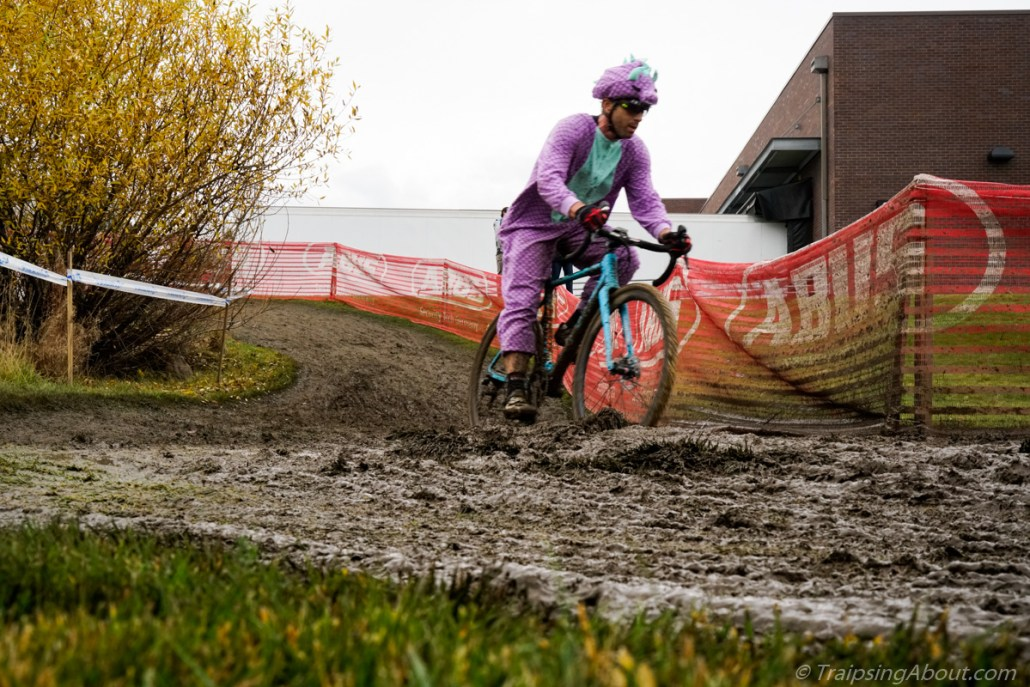 I'm not sure what's tougher, riding in deep mud or a purple dinosaur costume...