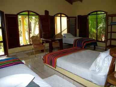 photo of the large windows, sitting table and beds