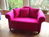 a pink miniature sofa