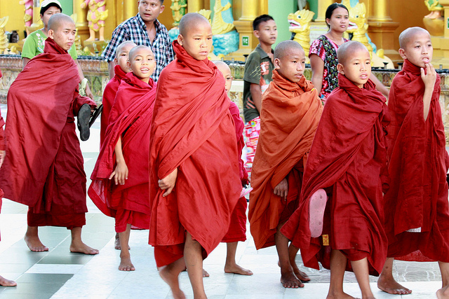 Burmese boys pray at Buddhist temple, Shinbyu Ceremony, spiritual ceremony for boys, novice Burmese boy monks, coming of age, spiritual ritual