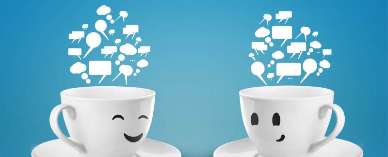 two happy cups with speech bubbles