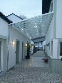 pedestrian walkway under glass canopy