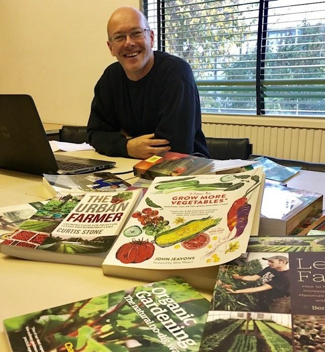 A photo of Elliott doing research on urban farm