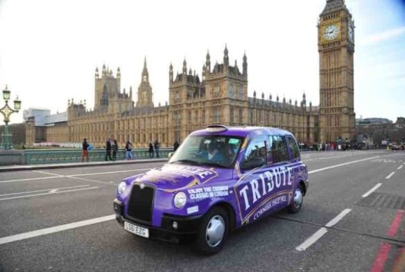 London Black Cab wrapped in eye catching purple, emblazoned with Tribute.