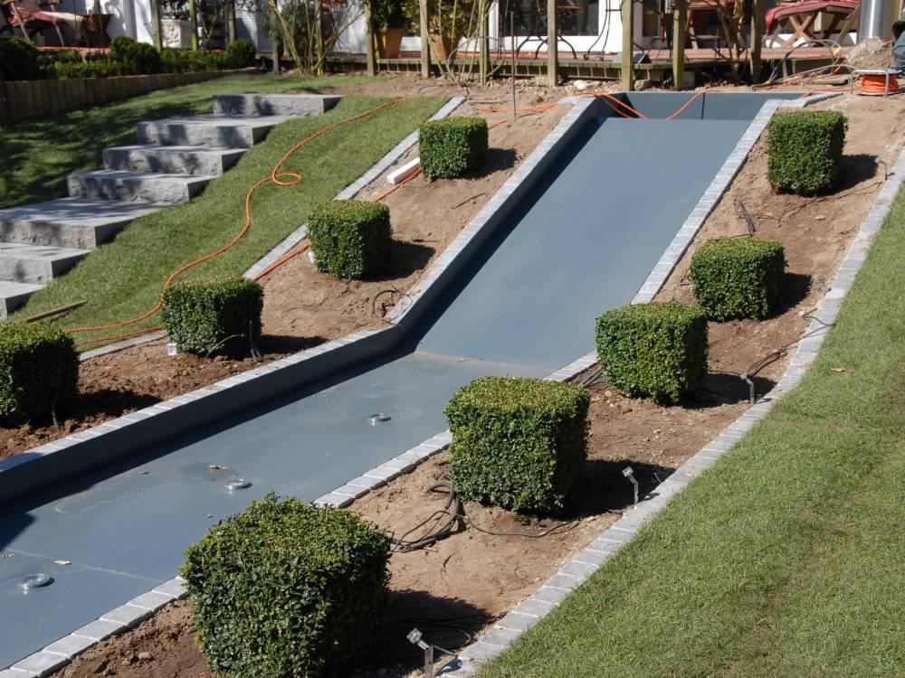 Galabau Mähler Wasserrutsche Garten