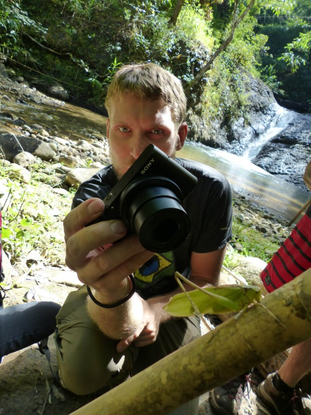 Christian fotographing a locust