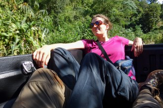 On the back of a pickup truck after a hiking trip near Pai