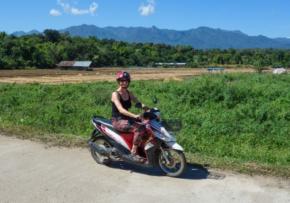 Maria on a scooter in Pais backland