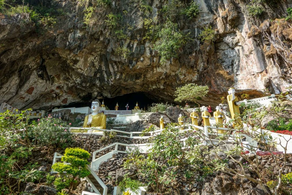 Entrance of Ya-The-Byan Cave lined with Buddha statues close to Hpa-An