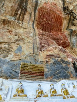 Votive tablets made of tiny clay buddhas covering the walls of Kawlgoon Cave near Hpa-An