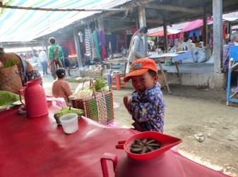 Small boy on Nanpan market in the south of Inle Lake