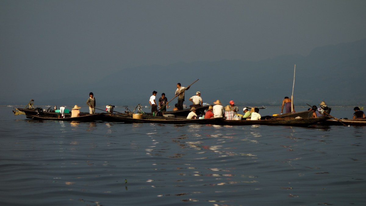 Longboats meeting for trading on Inle Lake