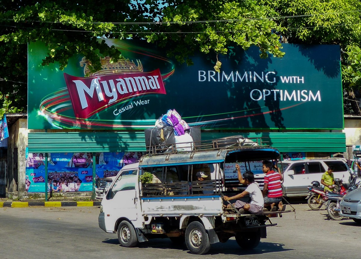 "Myanmar ""Brimming with Optimism"" advertisement in Mawlamyine"