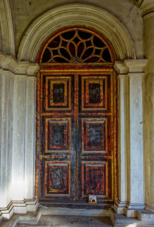 Wooden door inside the Yadanar Bon Myint temple in Mawlamyine